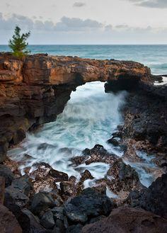 Po'ipu Lava Arch on the island of Kauai, Hawaii.