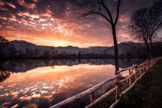 Sunset sky reflection - Sunset on a country pond, sky and clouds reflecting on the water.  By Stefano Gabriele Vallero