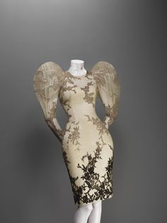 Alexander McQueen (British, 1969–2010)  Dress  Sarabande, spring/summer 2007  Cream silk satin and organza appliquéd with black degrade silk lace and embroidered in clear beads and sequins  Courtesy of Alexander McQueen  Photograph © Sølve Sundsbø / Art + Commerce
