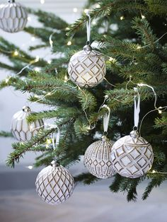 Twelve Copper and white tree decorations  Order your Balsam or Fraser Fir: Clippings, Miniatures & Trees on-line with Hilltop Christmas Tree!  http://www.hilltop-christmas-trees.com/