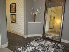 foyer with flor rug