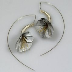 Earrings, Pawel Kaczynski.  Perfect for just about anything.  I don't know about you guys but whoo needs clothes with these earrings?