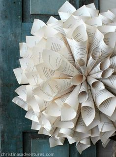 DIY rolled book page wreath ...gorgeous! Super inexpensive to make too!
