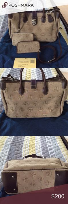 Dooney & Bourke   Double handled signature tote New without tags, beautiful Dooney &Bourke canvas and t'moro brown leather trim. Equipped with leather logo stamped key fob, shoulder strap, eye glass case, key keeper, and cosmetic pouch. Mint condition, never used. Dooney & Bourke Bags Satchels