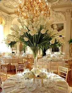 Tall, white, tulip wedding centrepieces Thinking that it's too fancy, but if it fits my budget i would not mind at all ...