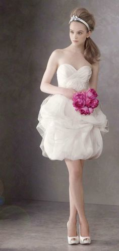 White by Vera Wang   The bride looks so elegant and doesn't even need the long train to do it. If you can work it, wear it! #gifts #expensivegifts #findgifts