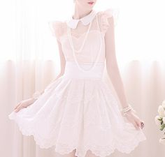Doll-like and sweet, frilly sleeves, peter pan collar, sweetheart neckline and a flouncy skirt, baby pink with pearls