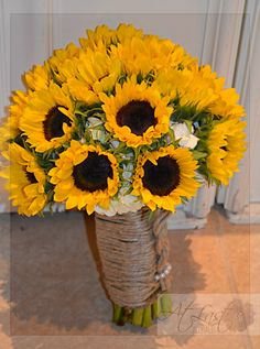 Sunflower Wedding Flowers Bridal bouquet of sunflowers and white hydrangea with twine wrap.  Design by: At Last Florals