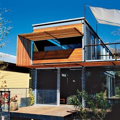 """Above the front patio, the designers created a trellis of Ipe, a Brazilian hardwood. This transformed the very important function of keeping the Texas sun at bay into one of the most striking elements of the house. The sun break wraps up and then over the second story with an artist's flair. """"It does more than just shade the windows,"""" says Bercy."""