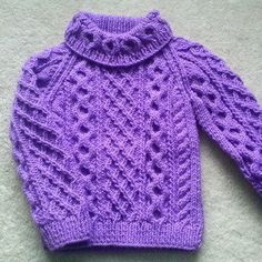 This child's aran sweater was inspired by my little granddaughter asking me to make her a special purple sweater (it's our favourite colour!). It is suitable for boys or girls, and you can make the neckline plain if you prefer, or follow the pattern. The actual garment measures 22, 24 or 26 inches around at the chest. There are five pages to the pattern, with written instructions and photographs of the sweater as it progresses. Worsted yarn was used for the pictured garment, you don't need…