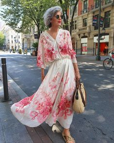 Printed maxi summer dress, sandals and woven handbag | Photo shared by Carmen Gimeno | For more style inspiration visit 40plusstyle.com