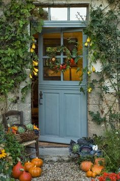I love a Dutch door and the blue is a perfect shade. Love the gravel - all a lovely and serene entry,