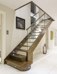 Another angle of this glass balustrade, showing built-in lights along the whole staircase. #StaircaseLighting #ABCGlass