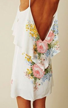 Backless Floral Dress. If I could get away with not wearing a bra I would love to wear this.