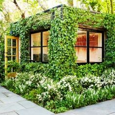 Scott Lewis Landscape Architecture designed the Parkside Garden featuring an ivy-covered art studio located in San Francisco, California