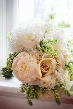 J.Bailey Occasions: Lucy's Bridal Florals & Details :  green hydrangea and cream peony (looks like lily of the valley too, I don't see the green hydrangea, but color scheme if nice, minus the roses).