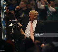 Donald Trump celebrates his victory over Vince McMahon at the main event of the night, 'Hair vs. Hair', between Vince McMahon and Donald Trump. WrestleMania 23 at Detroit's Ford Field in Detroit, Michigan on April 1, 2007.