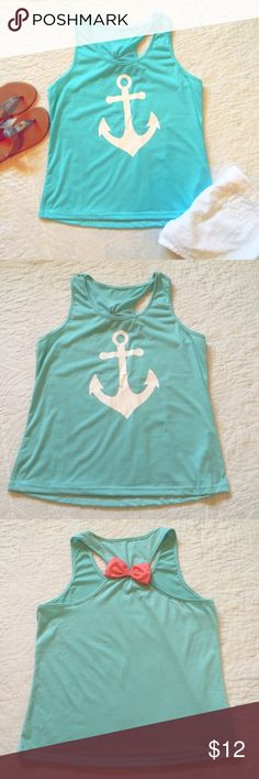 Blue nautical racer back tank with coral bow Adorable anchor racer back tank top with white anchor and coral bow on back! Super cute and summery!! Tops Tank Tops