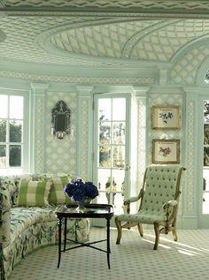 Mint green lattice, chintz, buffalo check pillows, tufted chair, framed botanicals - Diamond Baratta