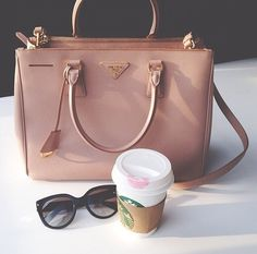 A Modern Gladiators Essentials: Prada, Starbucks, and the right pair of shades...