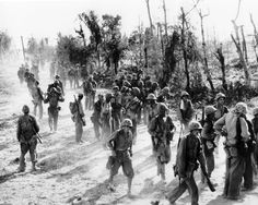 """The 1st Marine Regiment of the 1st Marine Division is pulled off the line at Peleliu in Sep, 1944 after losing 70% of their strength fighting over the Umurbrogol ridges, nicknamed """"Bloody Nose Ridge"""" by the Marines that fought there."""