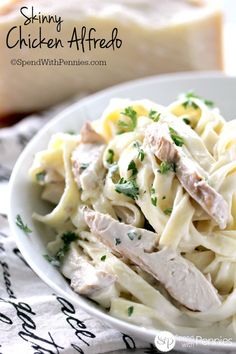 Skinny Chicken Alfredo is a rich, creamy & delicious pasta recipe lightened up! Bake or grill your chicken & add in your favorites; broccoli or mushrooms!
