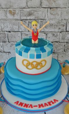 Swimming olympics cake and gold medal cookies