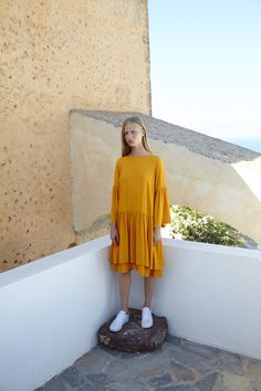SUNFLOWER DRESS. Golden hue dress, cut from luxurious mid-weight crepe with a drop waist falling into a double-layer skirt. Finished with pretty fluted sleeves and low keyhole back opening.