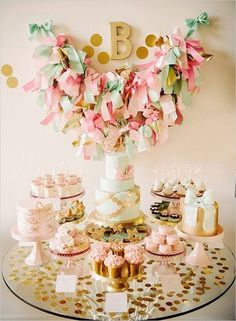 Bows!! . Pretty mint, gold and blush dessert table setting