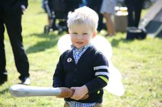 cute child at tipi wedding with fairly wings on