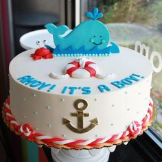 TOY WHALE BABY SHOWER IDEAS | the cake pops are whale shaped and cupcakes have whales on them