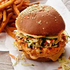 Chili-Glazed Salmon Burgers Pair juicy salmon patties with our homemade cilantro-cabbage slaw to create a burger with a crunch. Mayo spiked with Asian chili sauce adds pizzazz to the salmon recipe. Burger Recipes, Salmon Recipes, Grilling Recipes, Fish Recipes, Seafood Recipes, Cooking Recipes, Healthy Recipes, Gourmet Burgers, Grilling Tips