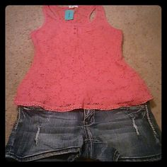 Tank top Coral lace tank has a few buttons on the front see through lace on the back. Lace with coral underneath. Never worn. active basic Tops Tank Tops