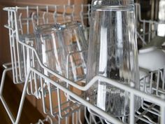 If your glassware is covered in a sad, milky film, try this technique suggested by the cleaning institute: Put two cups of vinegar in a bowl on the bottom of the dishwasher. Put cloudy glasses and other filmy non-metal dishes in the machine. Run a full cycle without detergent. Then rewash the load with detergent to remove any leftover vinegar.