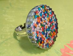 Bottle Cap on a ring filled with sprinkles and resin!