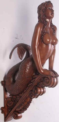 Mermaid figurehead sculpture  http://www.nauticaltropical.com/store/big/mermaids/MarineaSeaSiren-WoodLook2.jpg