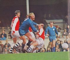 13th April 1968. Leicester City centre forward Frank Large is a victim of Arsenal duo Peter Storey and Terry Neil