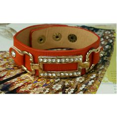Leather & rhinestone cuff bracelet NWT Trendy and chic genuine orange leather bracelet. Dazzled with a gold tone plate drenched with sparkling petite rhinestone. Adjustable three snap closure. Great bracelet for stacking. Brand new with tag. Jill Marie Boutique Jewelry Bracelets
