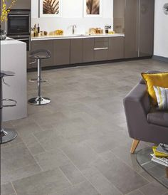 This kitchen looks like it has a stone floor but as its Karndean, it is much warmer and not hard like stone.