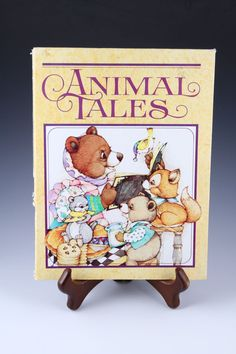 Animal Tales - a collection of childhood favorite stories is now a journal! Featuring a cover of furry friends surrounding mama bear with the