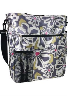 Stay in style with this floral diaper bag by Amy Michelle Go Totes. See one today by visiting Treehouse Kids Co.