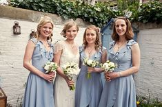Bridesmaids in pale blue BHLDN dresses, from 'Jenny Packham and a 1970s Veil For A Mad Hatters Tea Party Inspired, Elegant London Wedding'  http://www.cassandralane.co.uk/