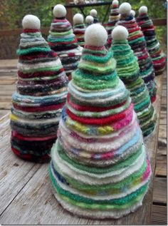 """♥ Felt Christmas Trees made by Ellen Price in Missouri and posted on her blog """"Ellens Creative Passage"""" in October, 2011. She hand cut the circles in 18 graduated sizes, and each tree used 2 of each size circle. She strung the circles together with 2 pieces of wire, which allowed them to bend, and topped each with a felted wool ball. ♥"""