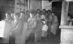 Monacan students inside the Staint Paul's Mission Schoolhouse at Falling Rock, Virginia - 1914