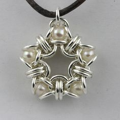 Pearl Star Chainmaille Pendant… Tons of other cool designs on this site….