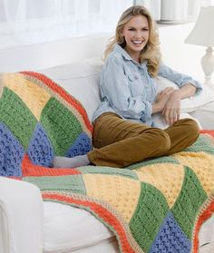 "Sampler Throw Free Crochet Pattern. Designed by Katherine Eng. Throw measures 47"" x 58"". RED HEART® ""Super Saver®"": 2 skeins each of 726 Coral A and 661 Frosty Green B; 1 skein each of 320 Cornmeal C, 624 Tea Leaf D, 382 Country Blue E, and 334 Buff F. Crochet Hook: 6mm . Yarn needle. Free Pattern More Patterns Like This!"