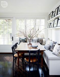 1 Chic & Sophisticated—An L-shaped banquette topped with plush toss cushions in various prints adds an inviting element to this kitchen's eat-in area.