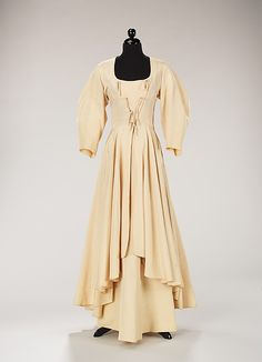 Entertaining ensemble, ~1938, worn by the chic Millicent Rogers, is made of an ivory slubbed silk, an example of how Valentina used unexpected fabric choices, rather than the ubiquitous lamé of the period. Instead of using a glamorous fabric in a simple cut, she combines an inventive bodice treatment that refers to the corseted bodices of the 18th-century peasant class with a signature barrel-shaped sleeve to craft an ensemble for a modern, stylish woman.