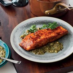 Chef Way At Mesa Grill in New York City, Bobby Flay presents his sweet-spicy salmon with three different sauces, including tomatillo salsa, black bean sauc...