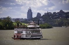 One of the B&B Riverboat cruises on the Ohio River with the Cincinnati skyline and Mt. Adams (to the right) in the distance. I've done these cruises and seen a similar view (though not with the Princess Diana Tower) many many times.